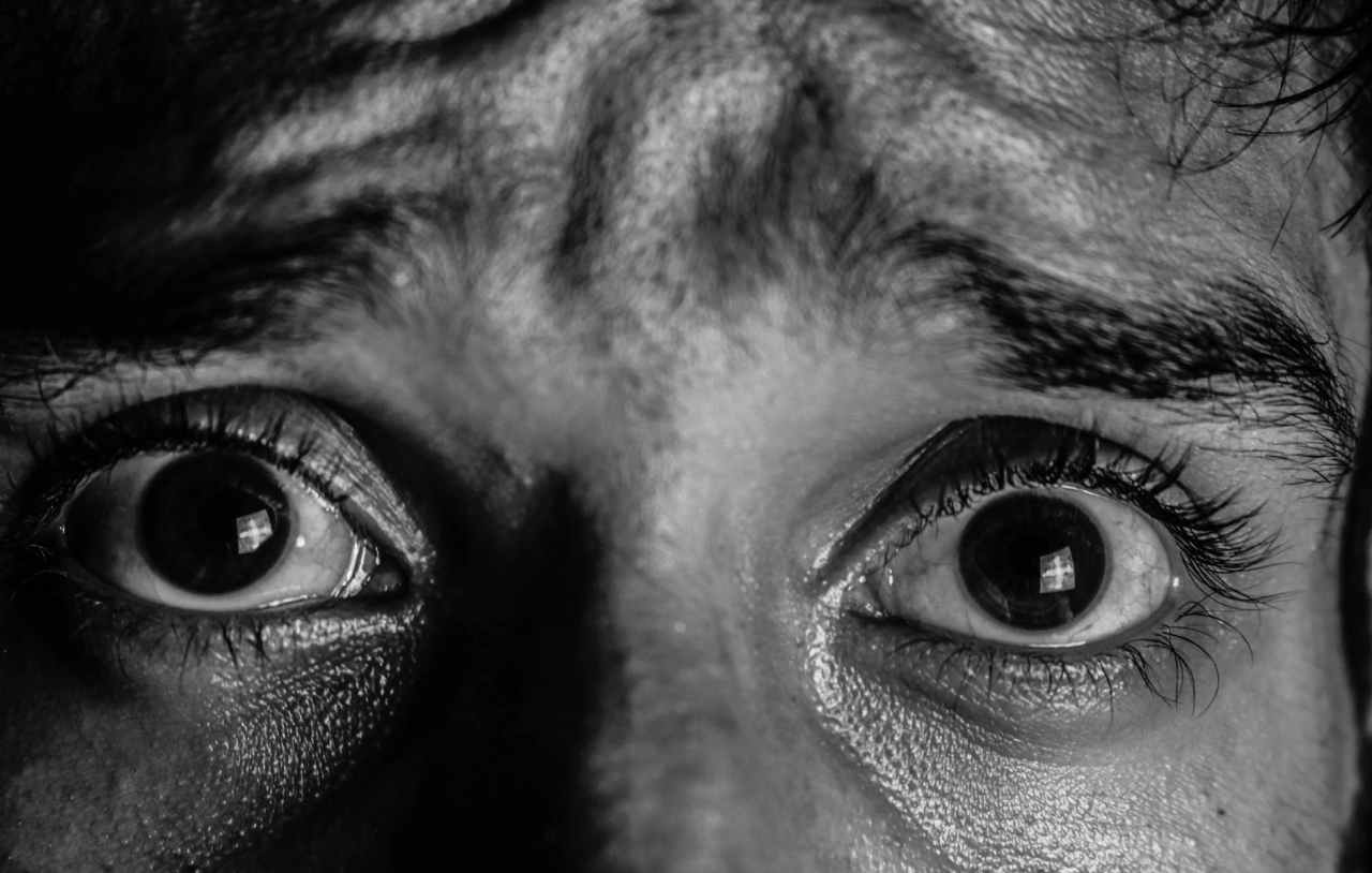black and white close up eyeball eyebrow